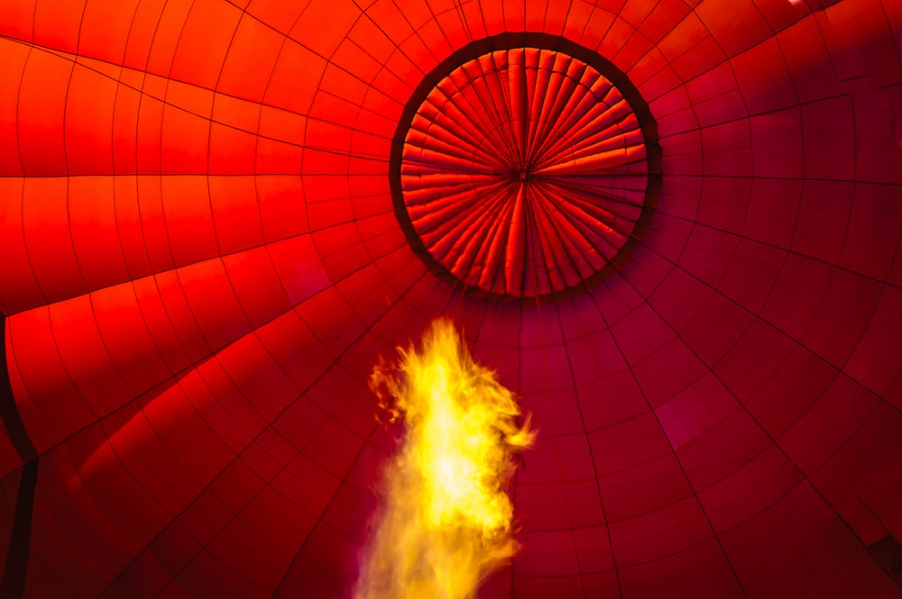 red hot air balloon with fire