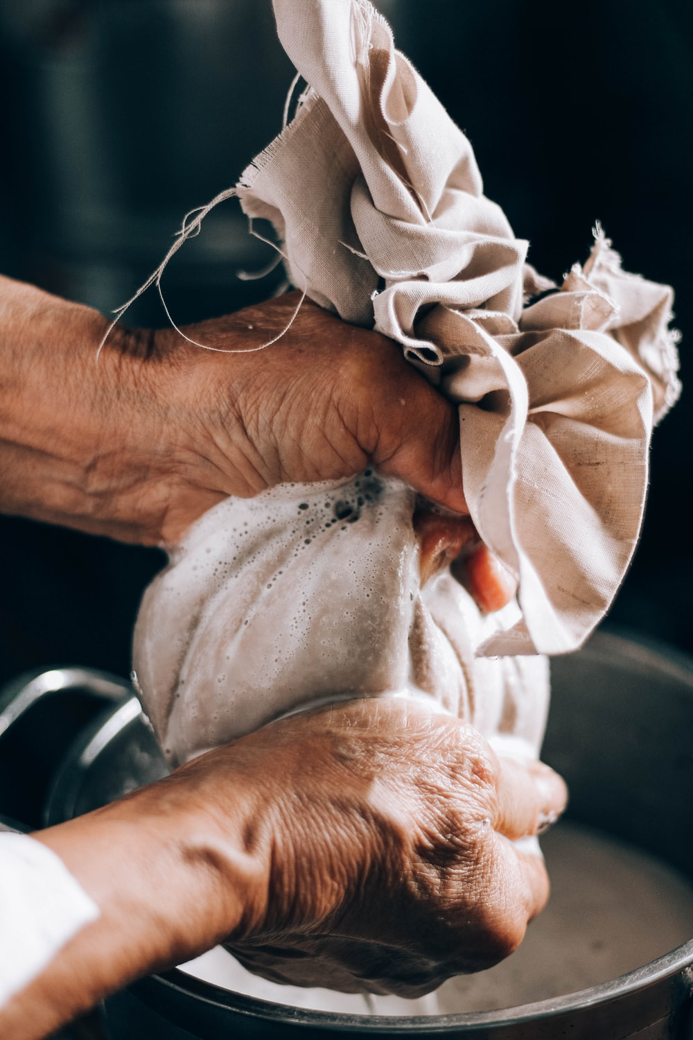 person holding white textile on left hand