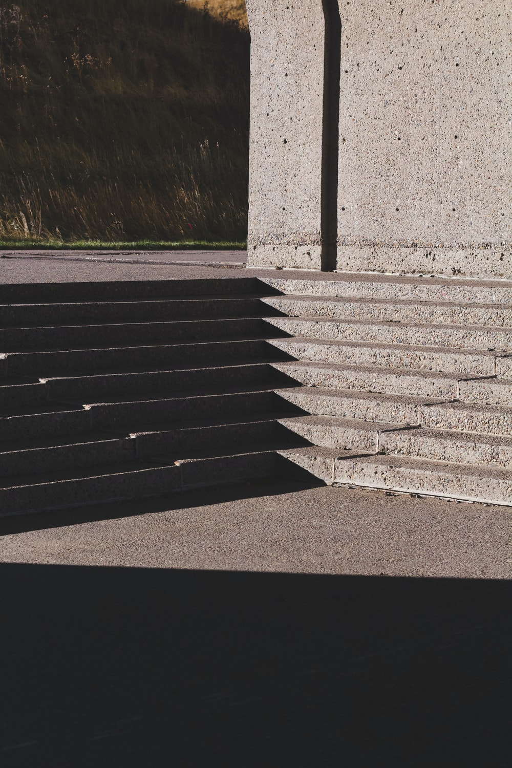 gray concrete stairs near green grass during daytime