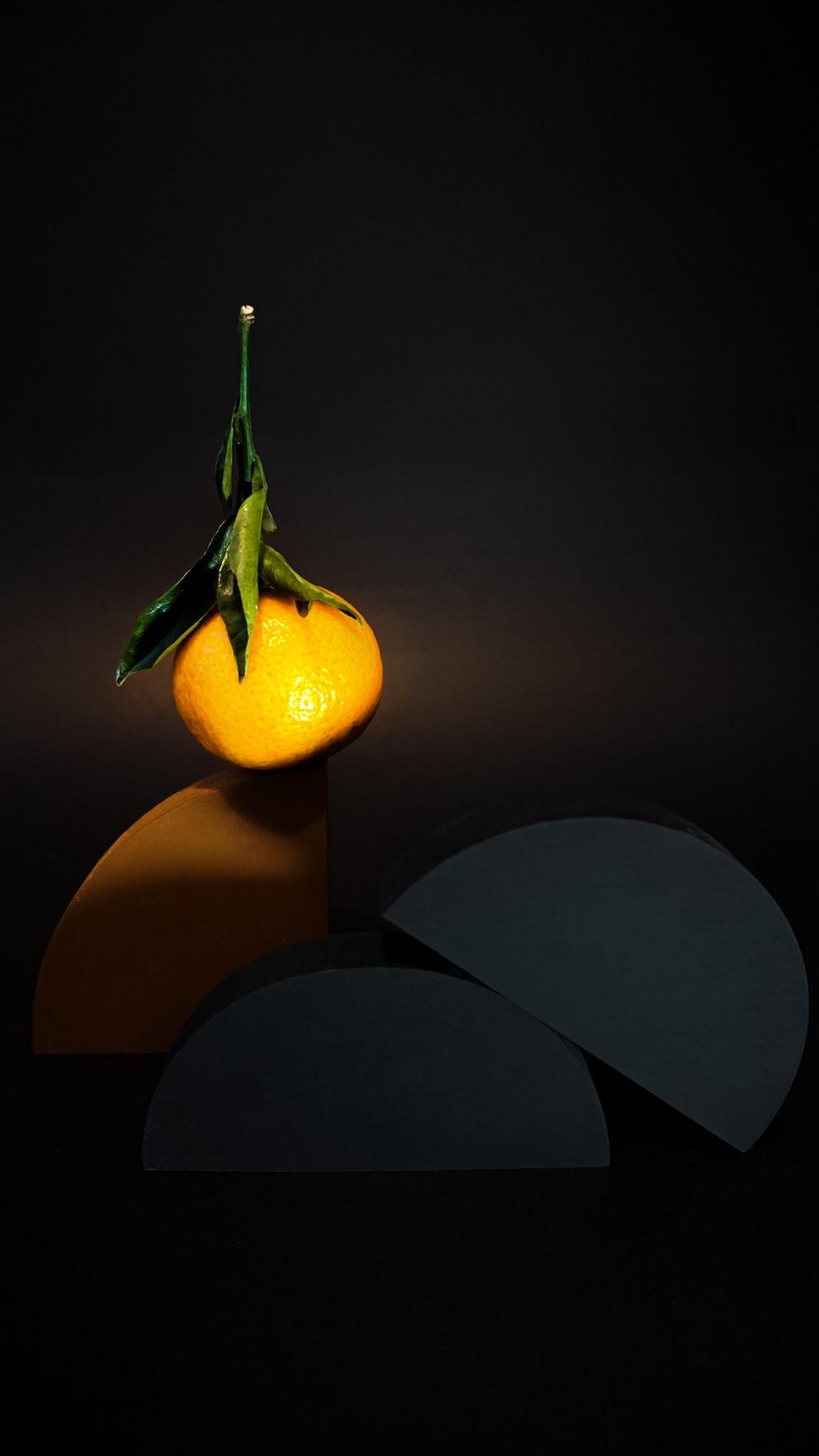 orange fruit on black table