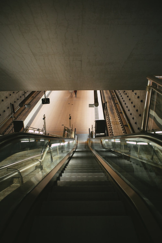 black and silver escalator inside building