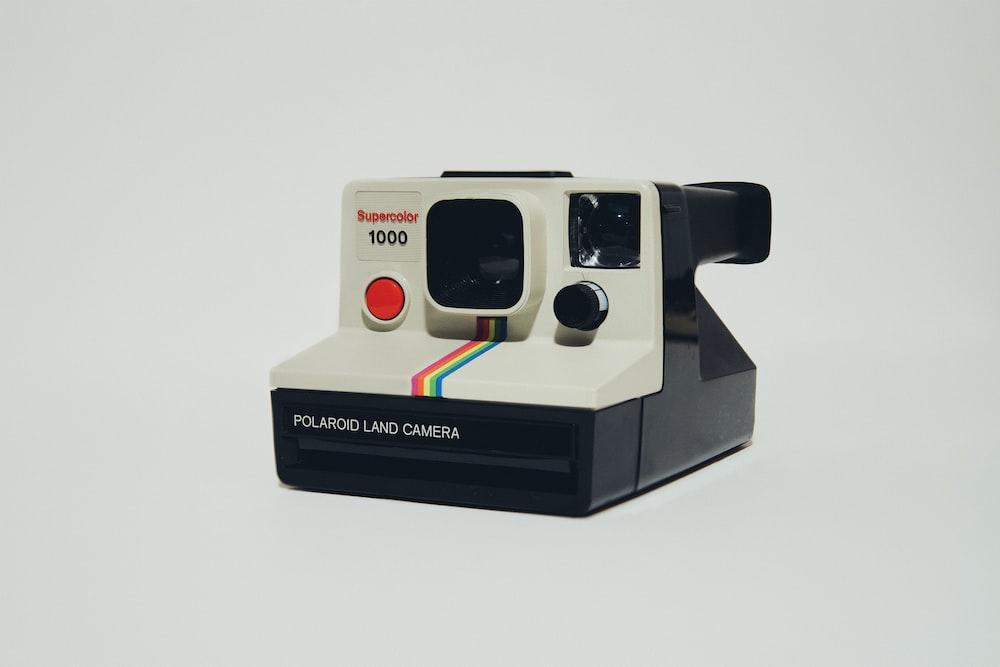 white polaroid instant camera on white surface