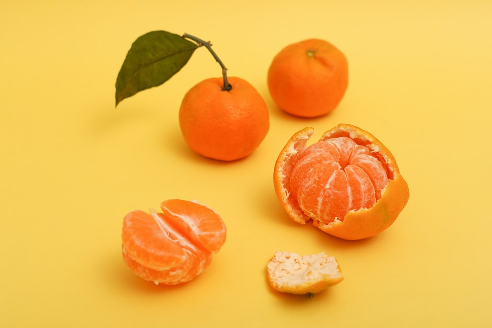 sliced orange fruit beside white cheese