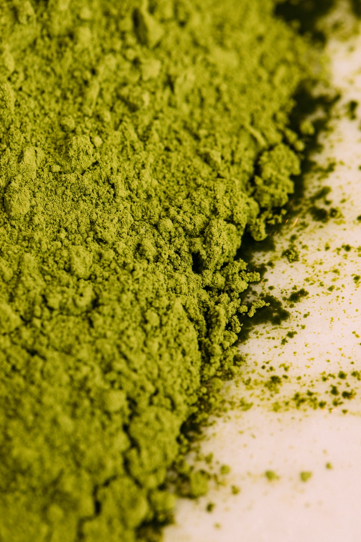 green powder on white surface