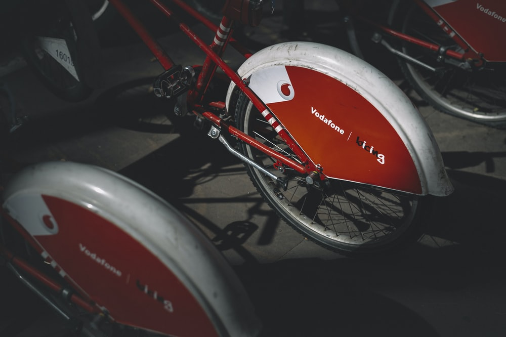 red and white honda motorcycle