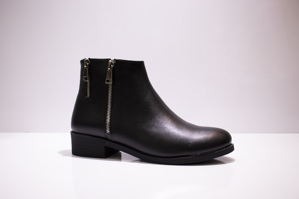 black leather boot on white table