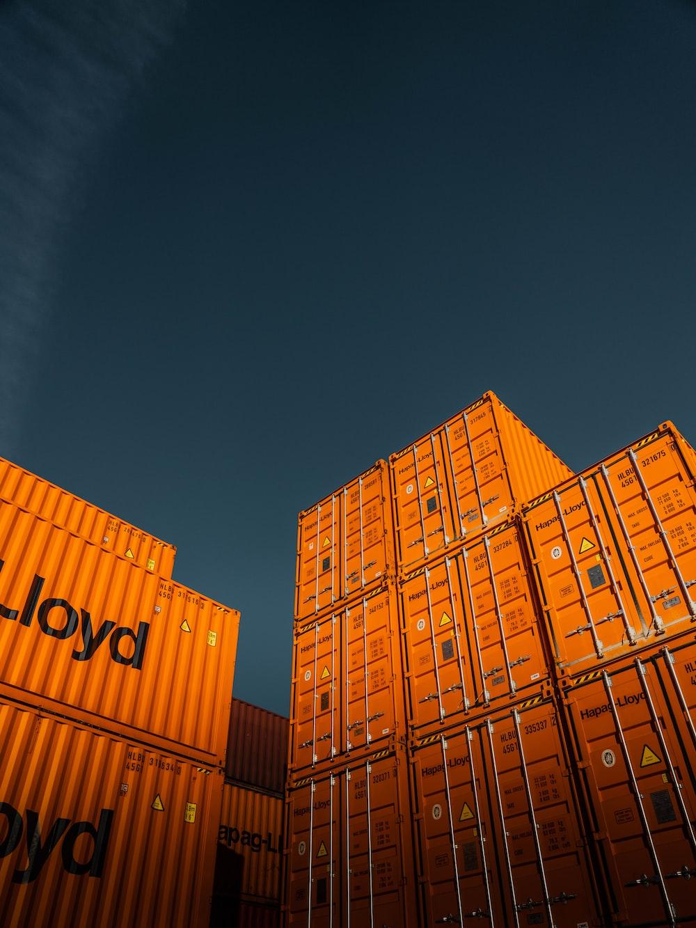 brown cardboard boxes under blue sky during daytime