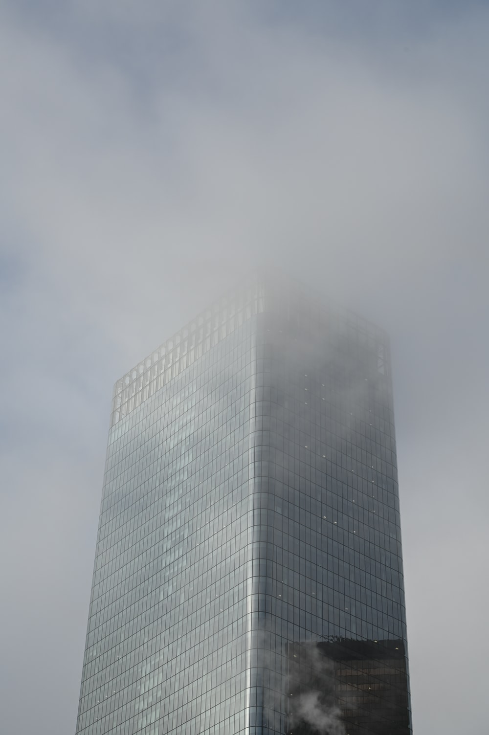 gray high rise building under gray sky