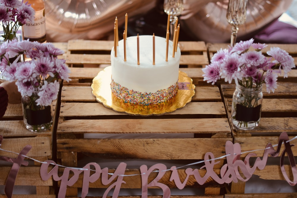 yellow and white cake on brown wooden table