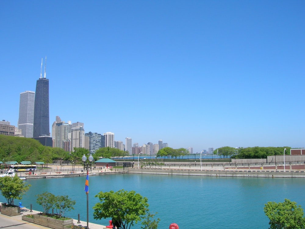 body of water near city buildings during daytime