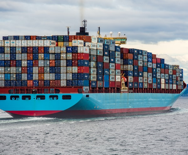 blue and red cargo ship on sea during daytime