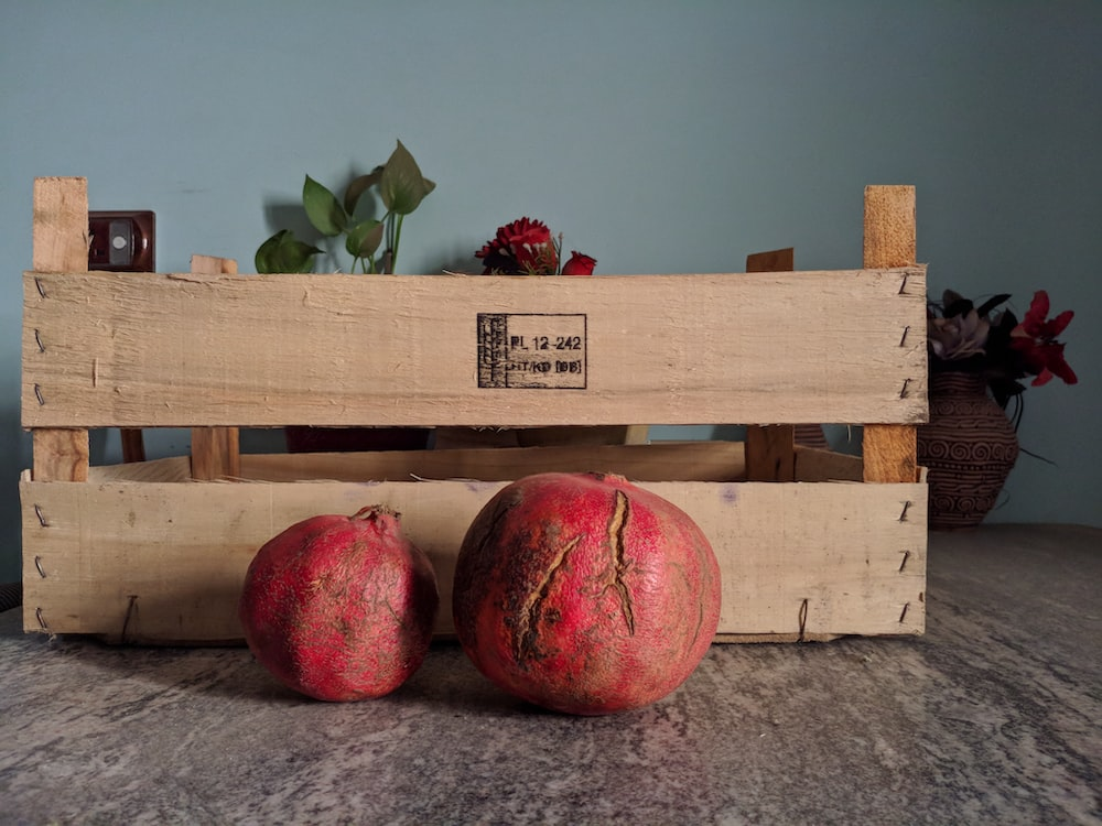 red apples on brown wooden crate