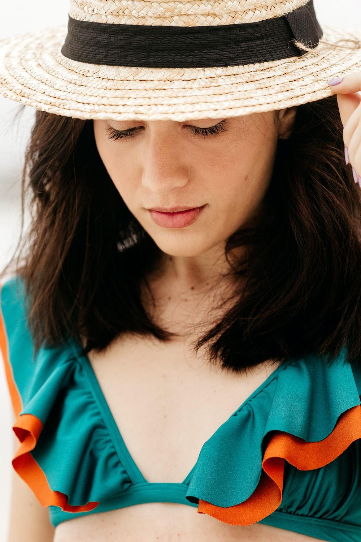 woman in blue shirt wearing white sun hat