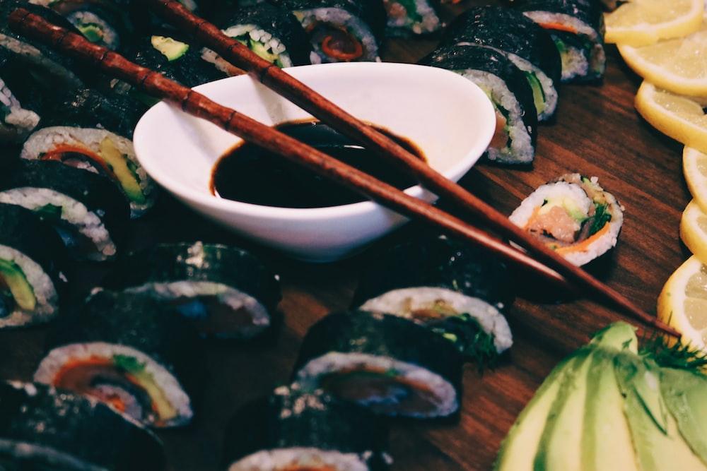 brown chopsticks on white ceramic bowl