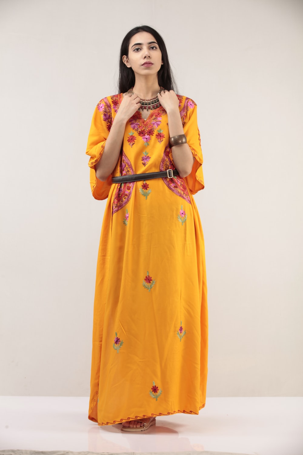 woman in yellow and white floral dress