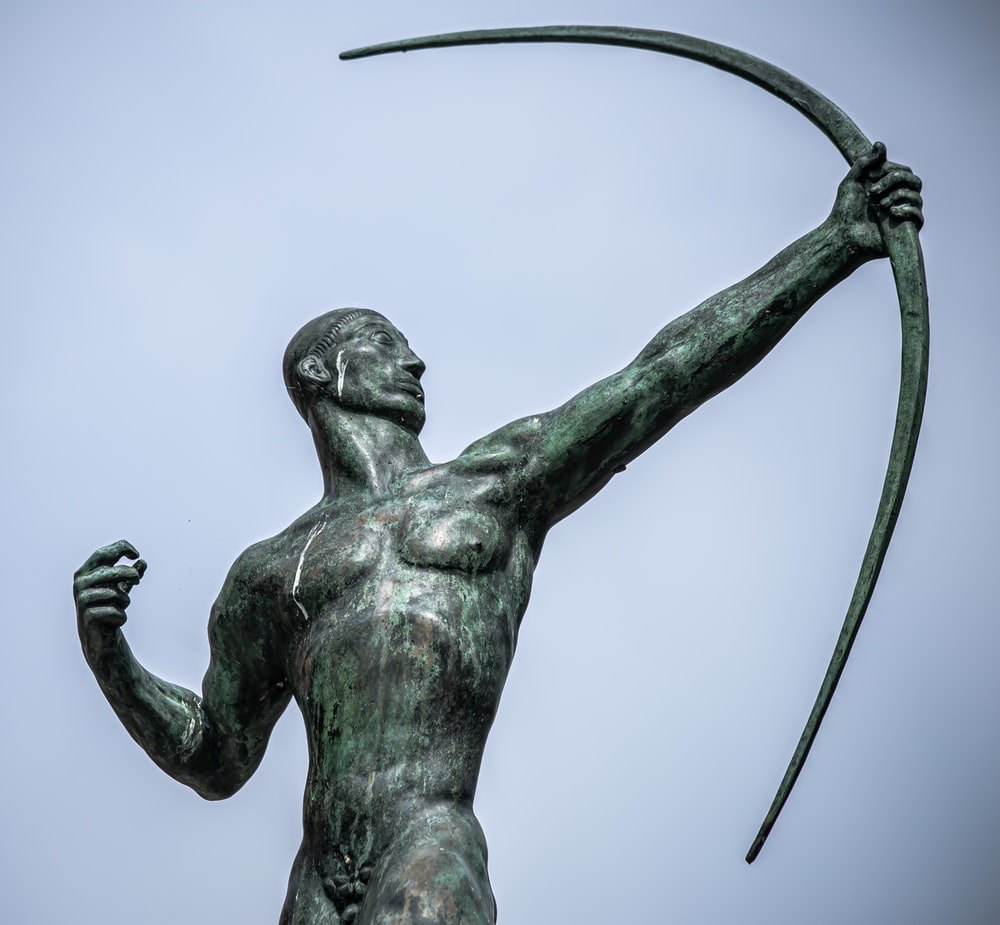 statue of man holding sword