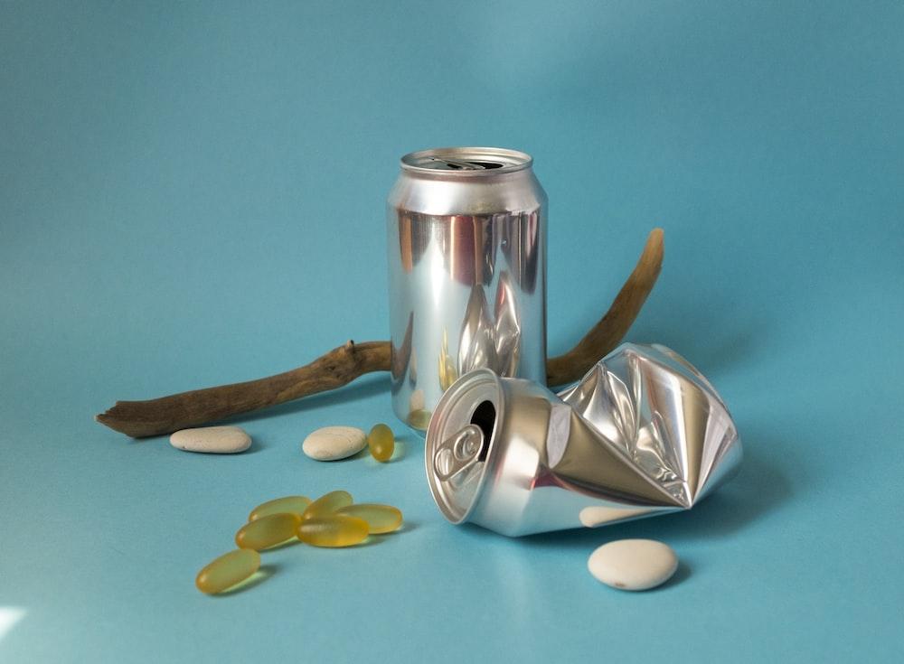 stainless steel vacuum flask on teal textile