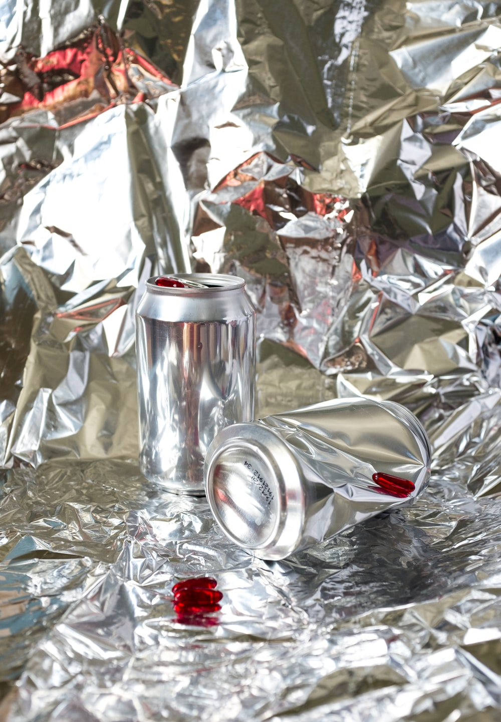 silver can on silver foil