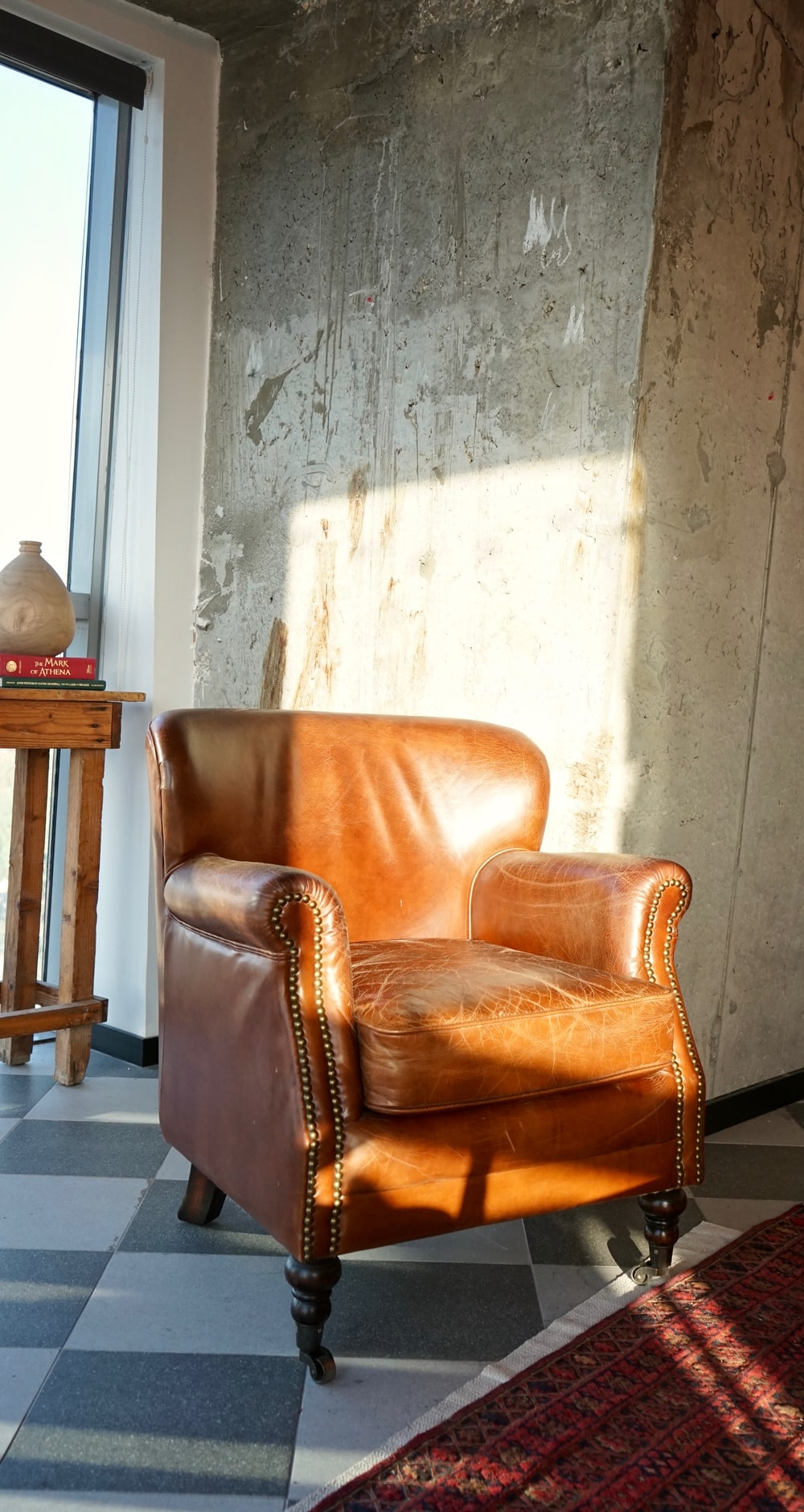 brown leather armchair beside brown wooden table