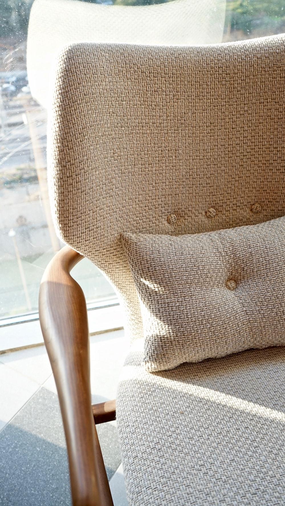 gray throw pillow on white wooden chair