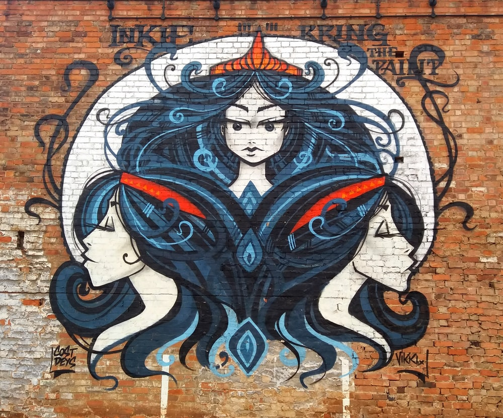 blue red and white woman with wings wall art