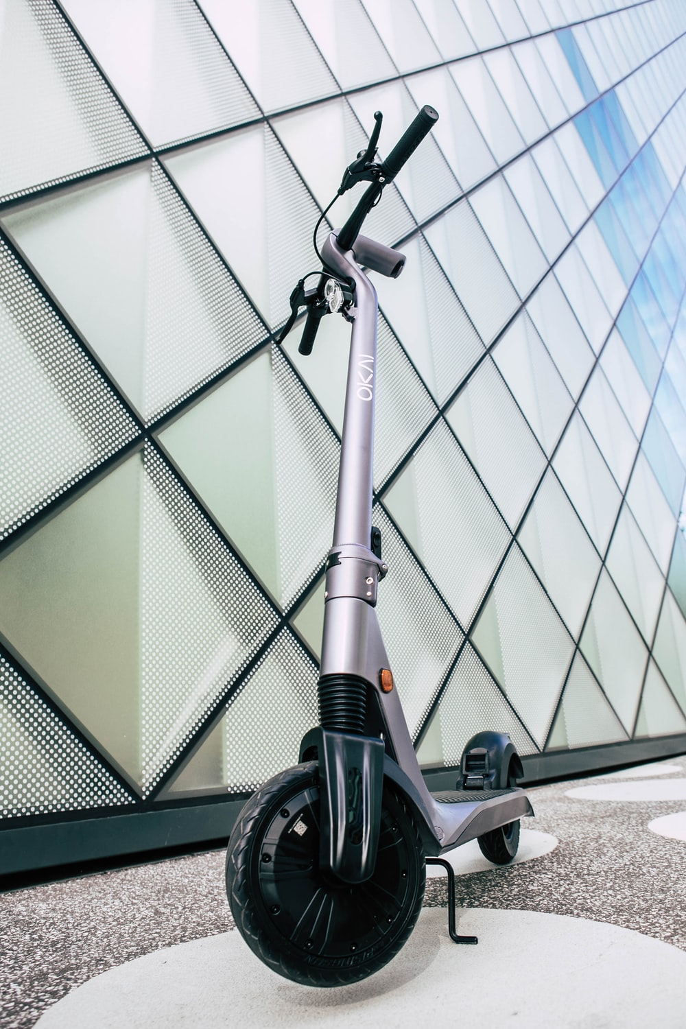 black and gray bicycle near glass wall building