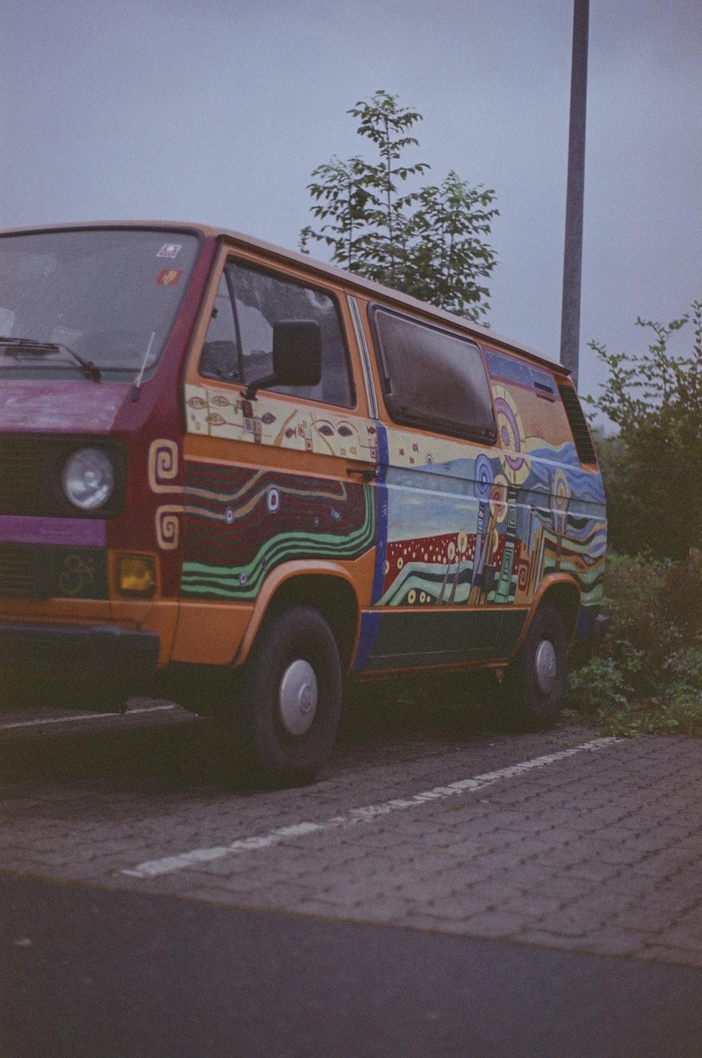 orange and blue van on road