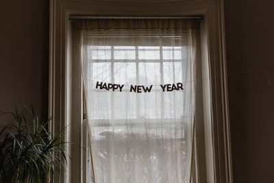 white window curtain during daytime new year's zoom background