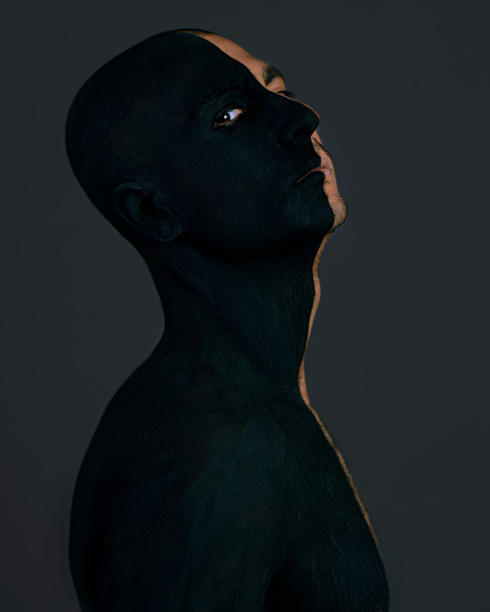 black statue of man with white background