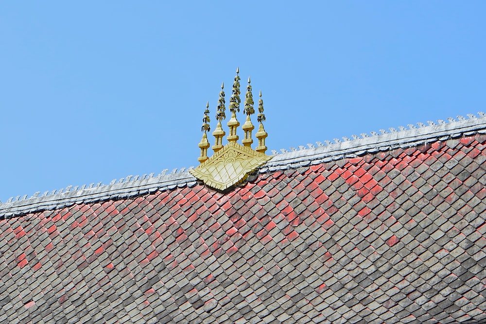 gold buddha statue on roof