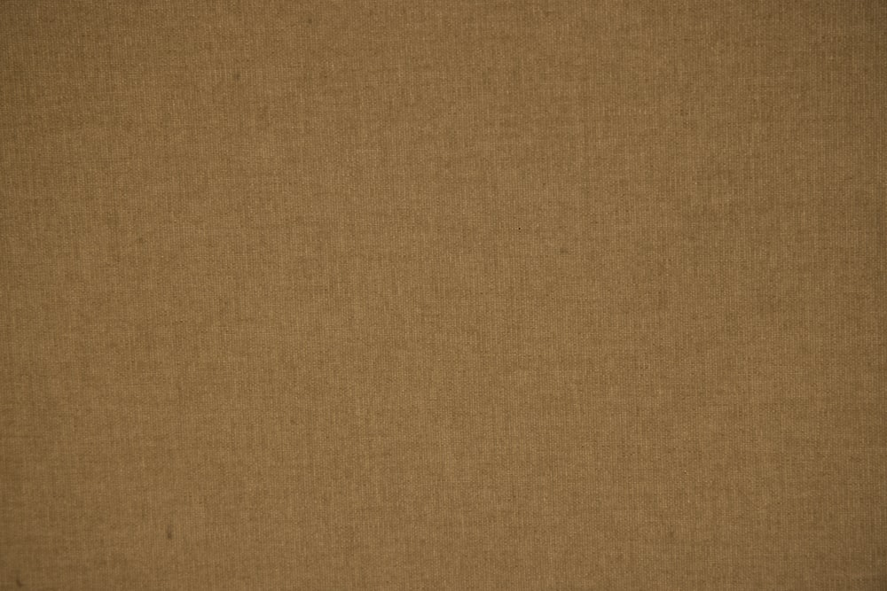 brown textile on brown textile
