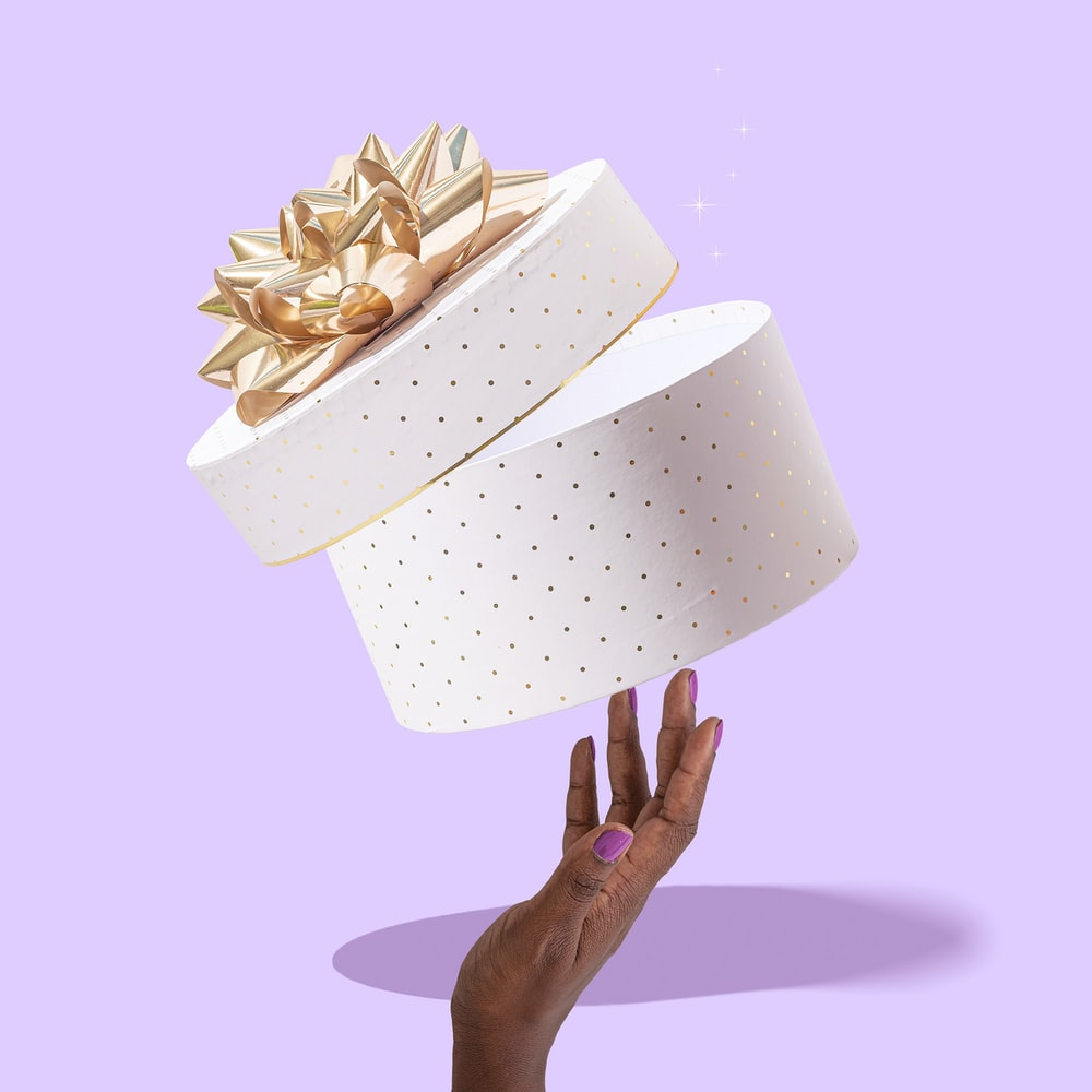 white and brown paper boat