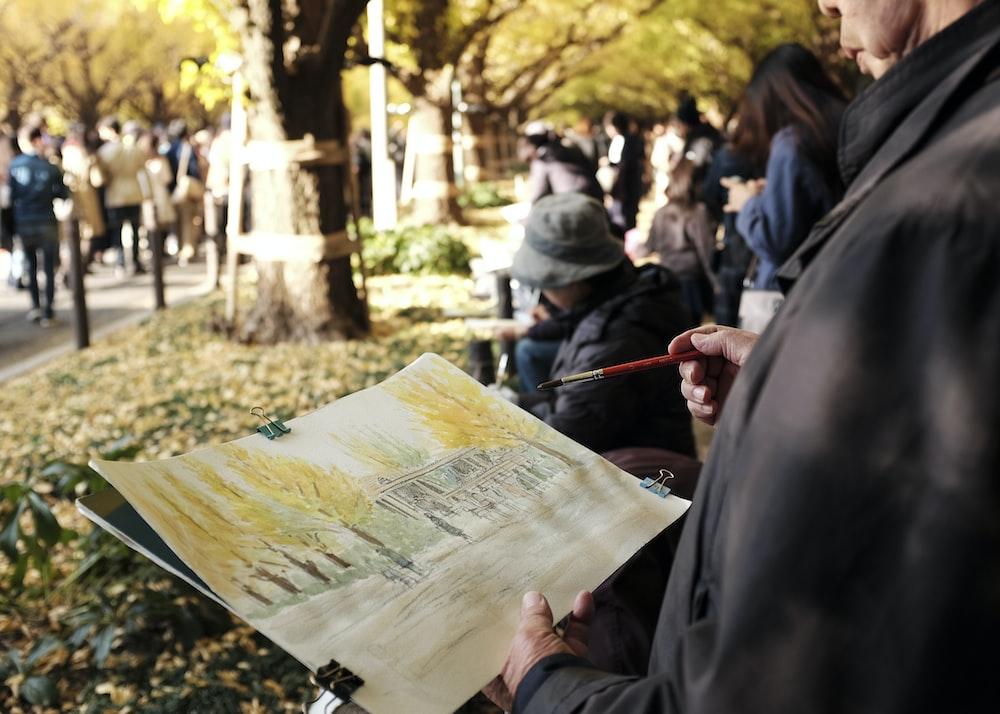 people gathering on park during daytime