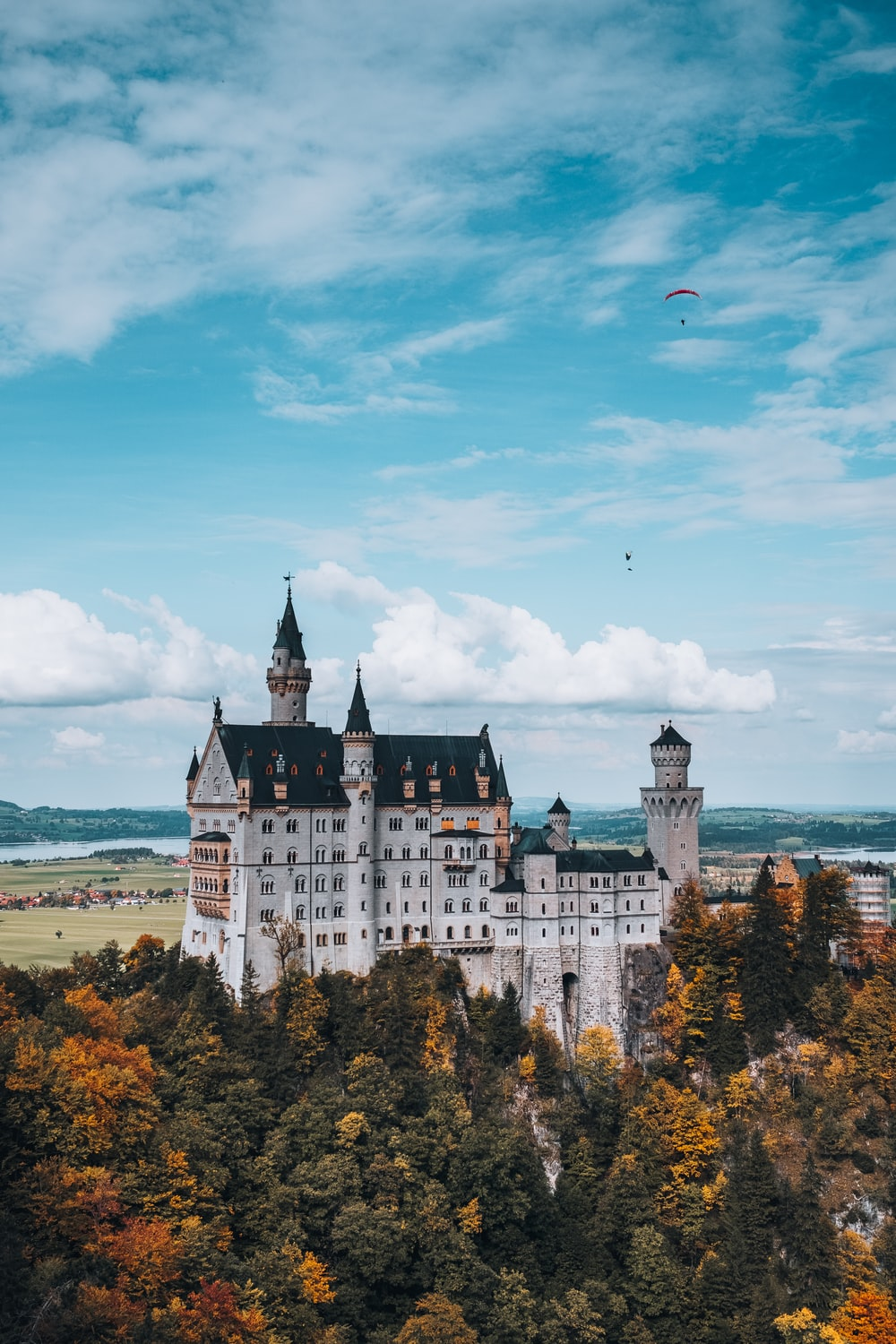 white and blue castle near body of water during daytime