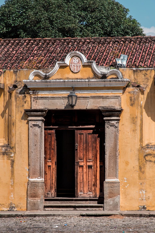 brown wooden door on brown concrete building