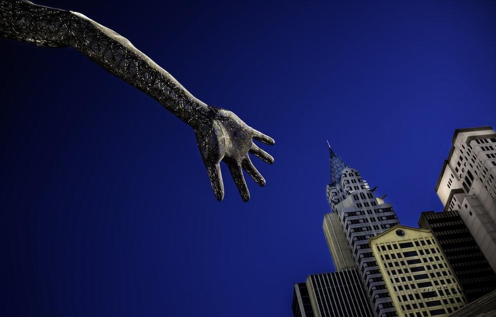 black eagle statue near white concrete building under blue sky during daytime