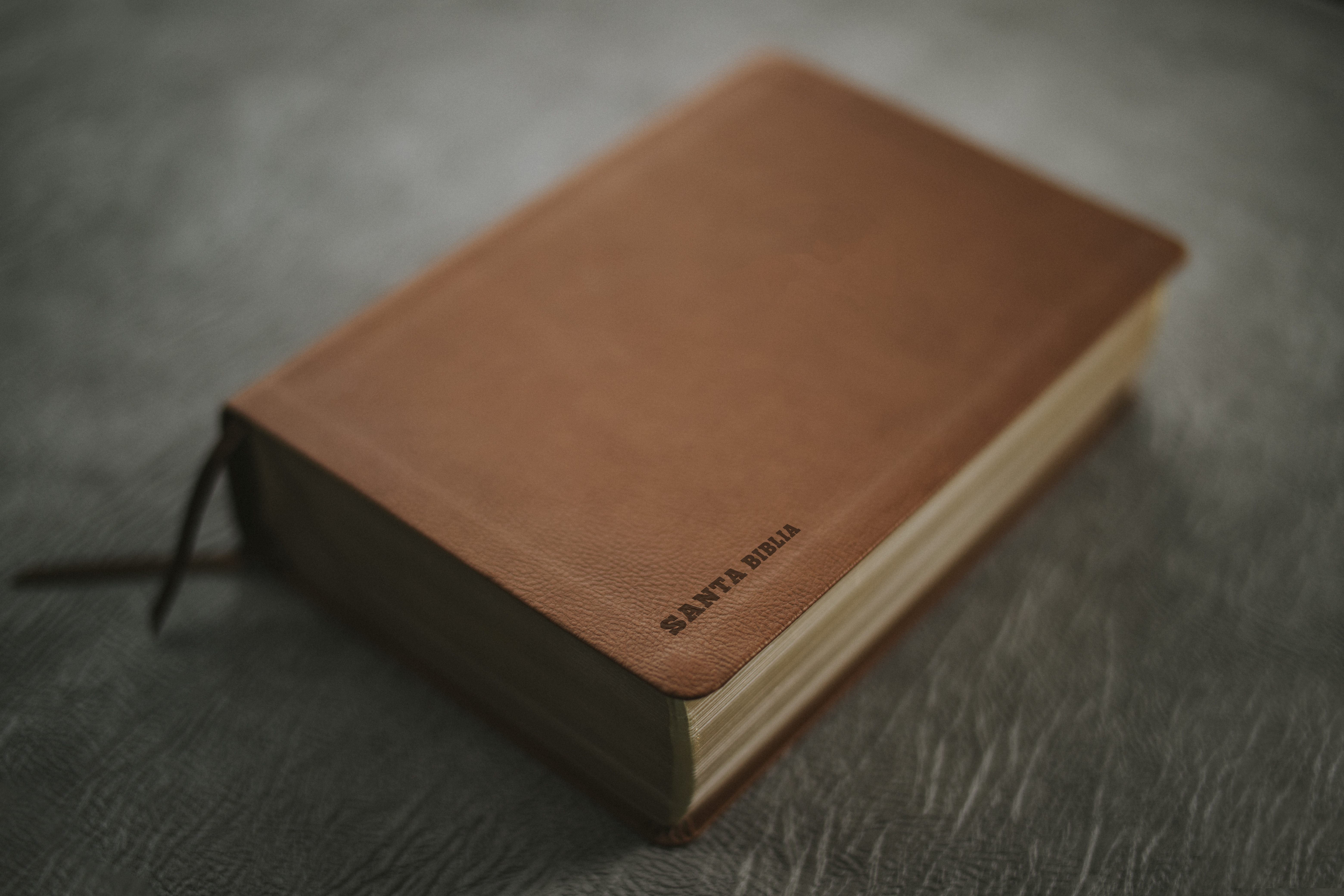 brown book on black wooden table