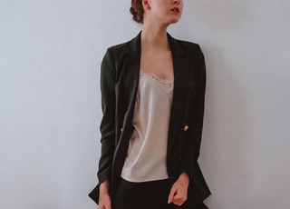 woman in black blazer and white dress shirt