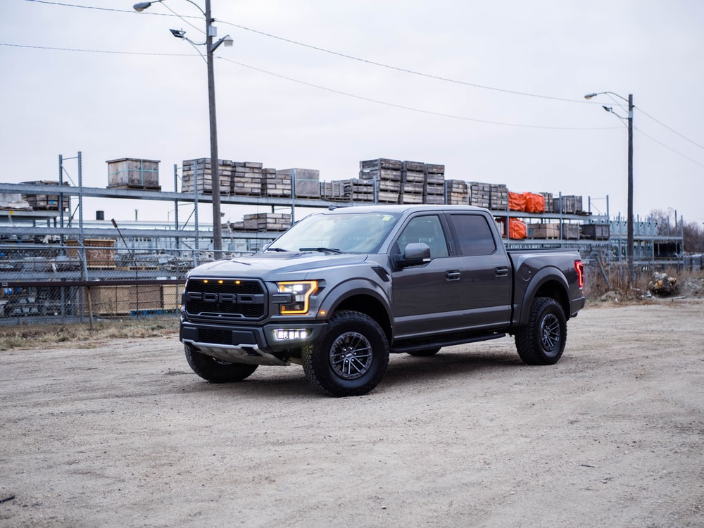 black chevrolet crew cab pickup truck on road during daytime