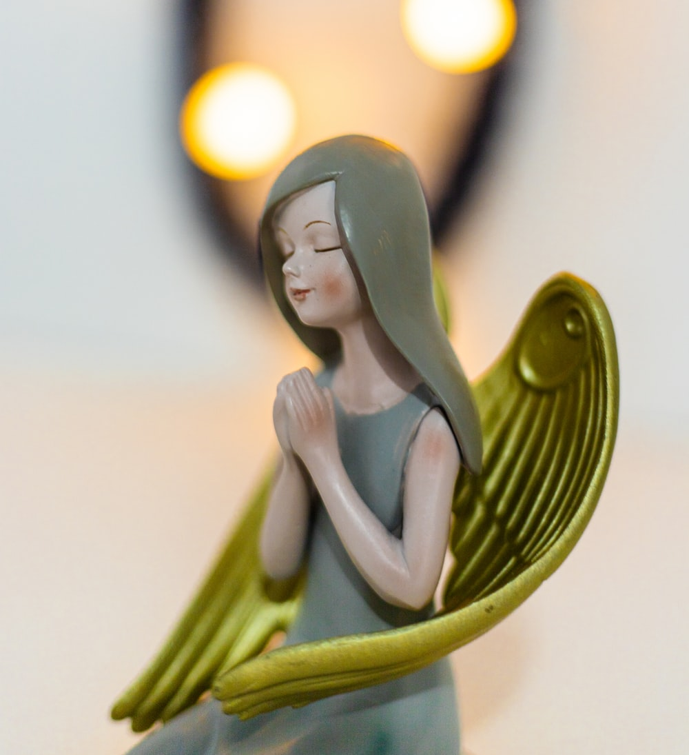 woman in green dress figurine