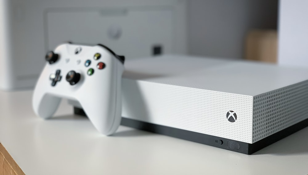 white xbox one console on white table