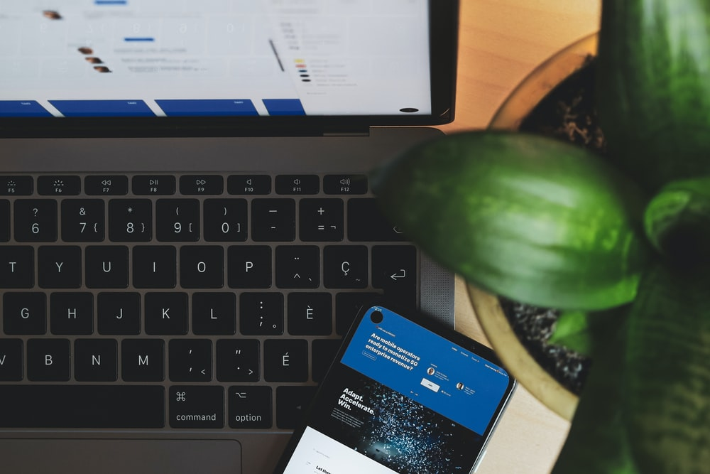 blue and white visa card on black and gray laptop computer