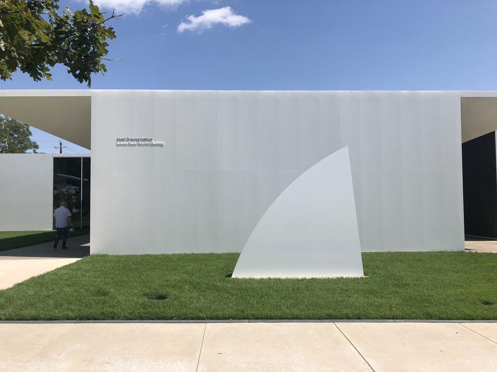 white concrete building near green grass field during daytime