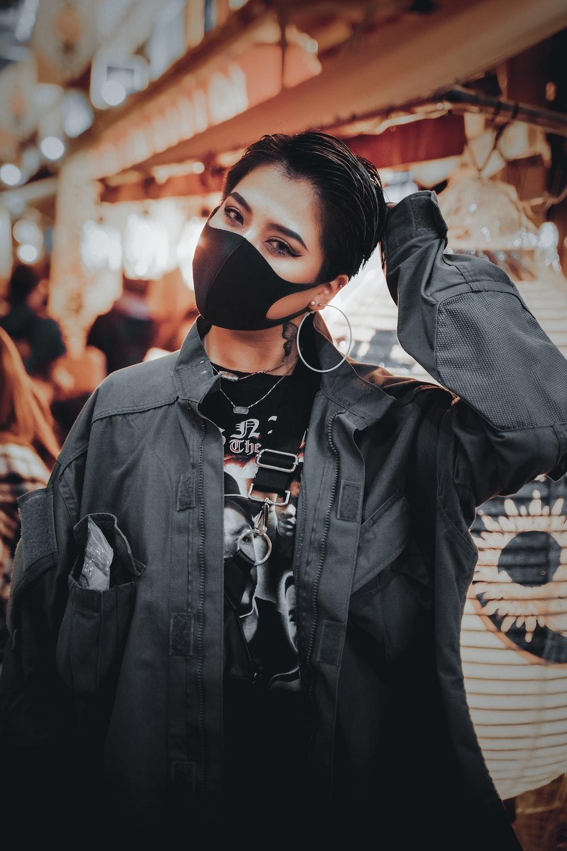 woman in black leather jacket wearing black knit cap
