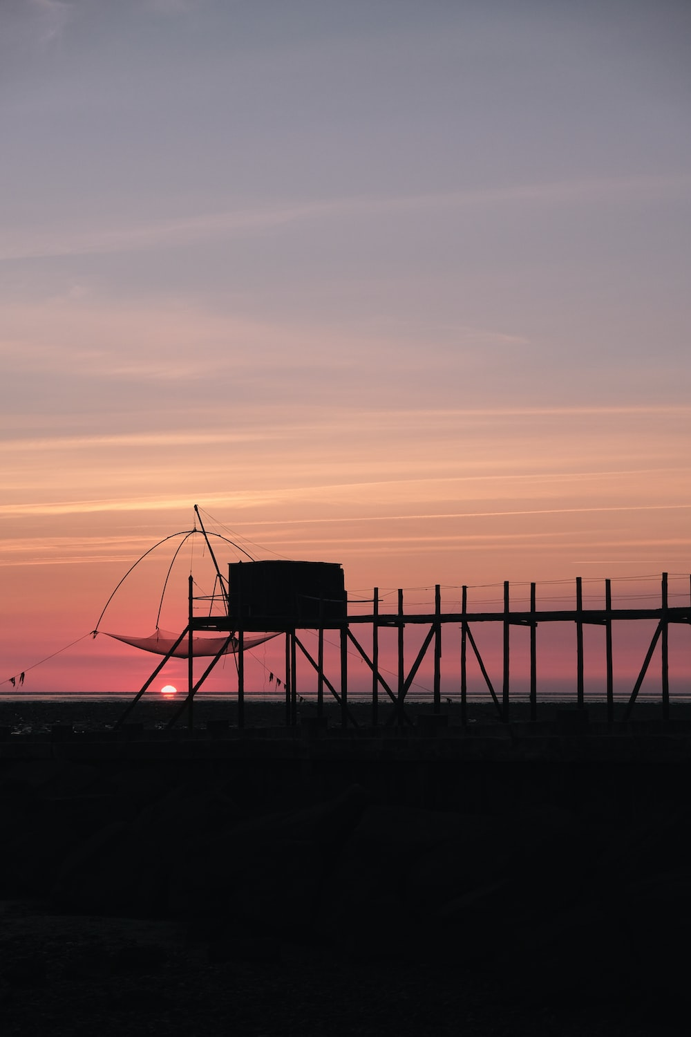 silhouette of lifeguard tower during sunset