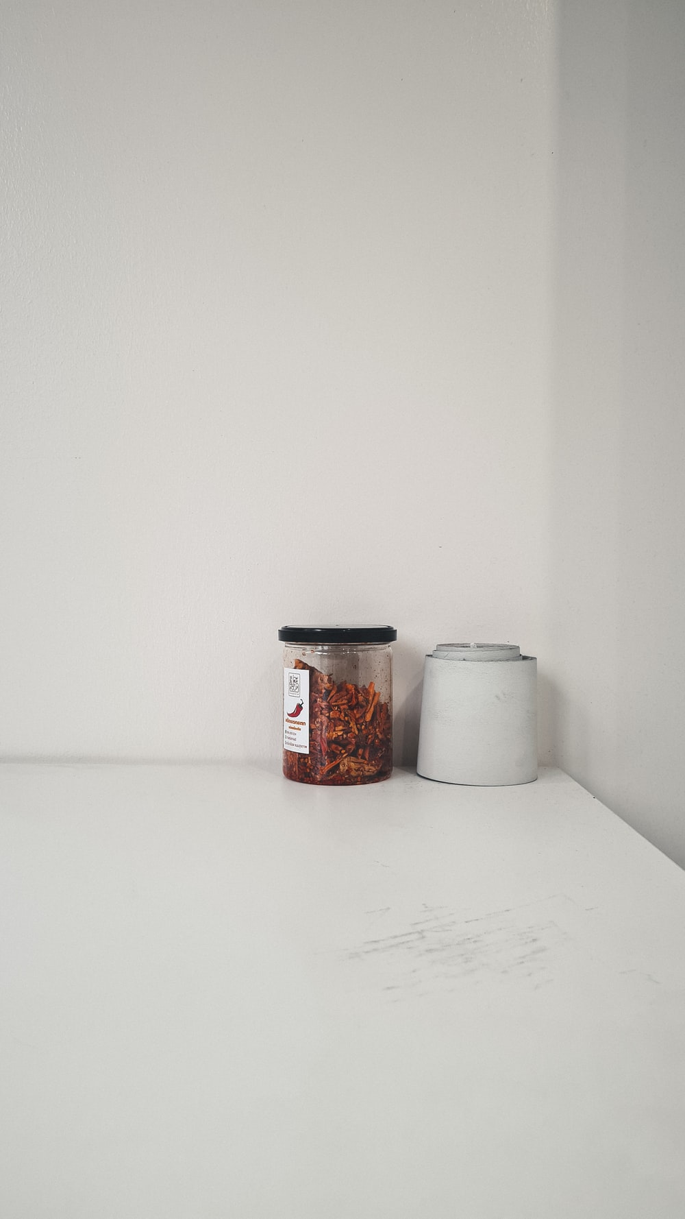 white and red plastic containers on white table