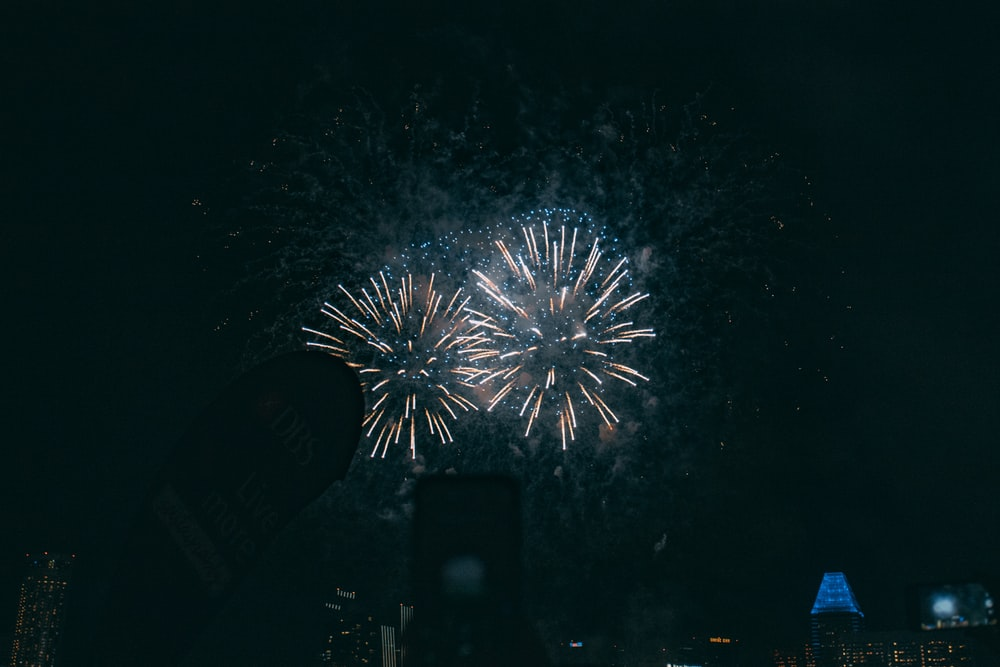 white and blue fireworks during nighttime