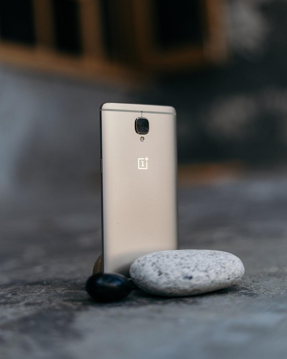 gold iphone 6 on black stone