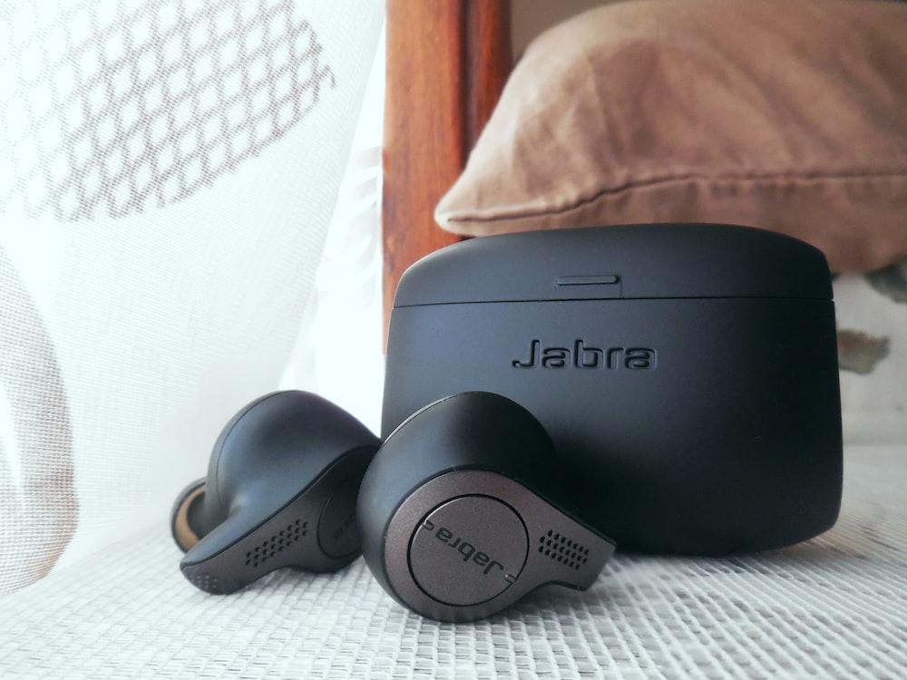 black sony headphones on white textile