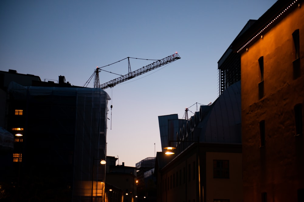gray crane near building during night time